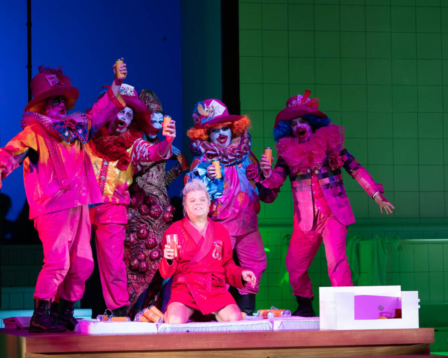 PETER HOARE as Orpheus the Man with the clowns. THE MASK OF ORPHEUS by Harrison Birtwistle ENO.